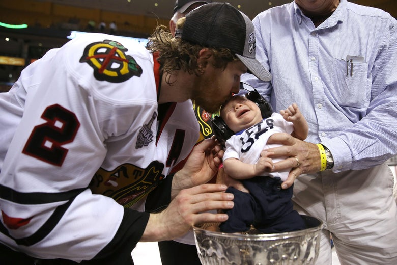 BOSTON, MA - JUNE 24:  Duncan Keith #2 of the Chicago Blackhawks celebrates a 2-1 victory over the Boston Bruins with his son following Game Six of the 2013 NHL Stanley Cup Final at TD Garden on June 24, 2013 in Boston, Massachusetts.  (Photo by Bruce Bennett/Getty Images)