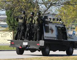 A swat team arrives at Fort Hood. Click image to expand.