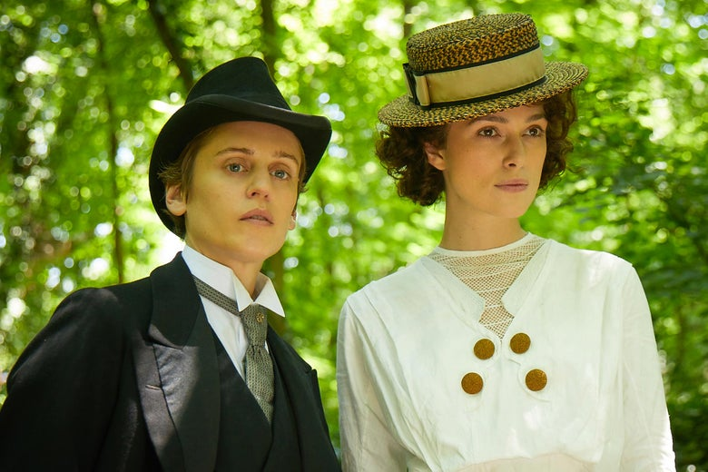 Denise Gough in a masculine suit and Keira Knightley in a white dress and straw hat.