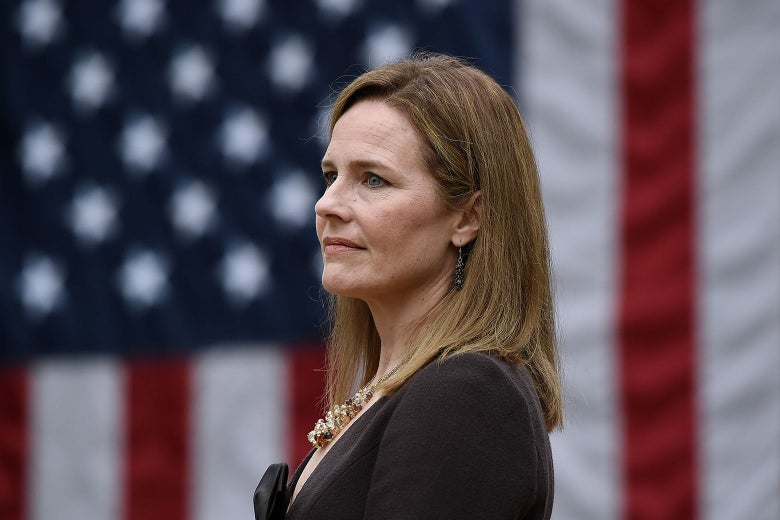 Amy Coney Barrett in front of a U.S. flag