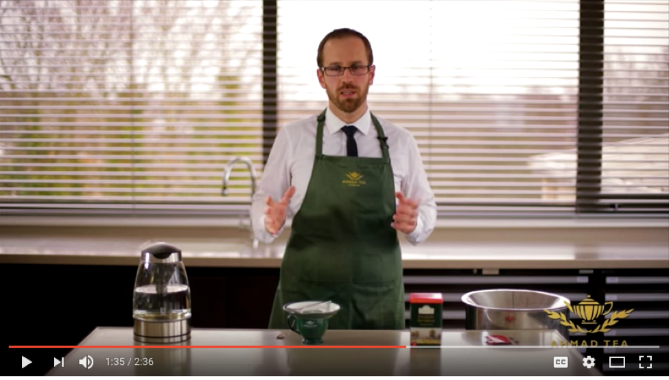 Screen capture from YouTube showing a man in an apron about to prepare food.