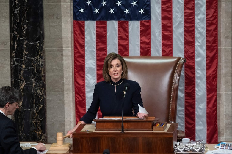 Nancy Pelosi at a podium in the House of Representative holding a gavel, with an American flag behind her.