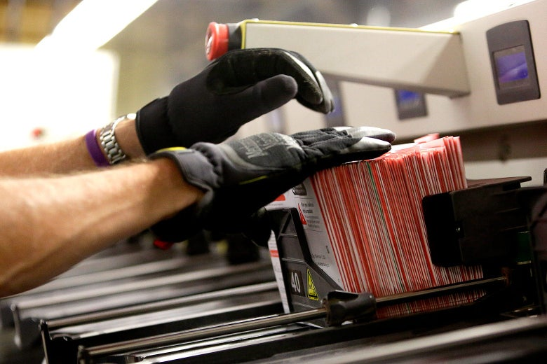 An election worker takes ballots from a sorting machine in Renton, Washington on Election Day.