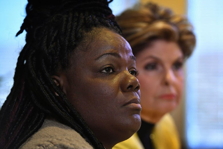 Essie Grundy (L) sits beside attorney Gloria Allred as they announce their race discrimination lawsuit against retail giant Walmart in Los Angeles, California on January 26, 2018. Essie claims that on a shopping trip to her local Walmart she discovered that all the hair products used specifically by African Americans were locked away in glass anti-theft cabinets, whereas all hair products used by others were left on open shelves.  / AFP PHOTO / Mark RALSTON        (Photo credit should read MARK RALSTON/AFP/Getty Images)