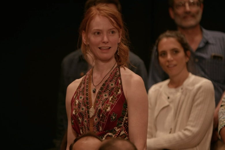 Alicia Witt, standing in a theater audience.