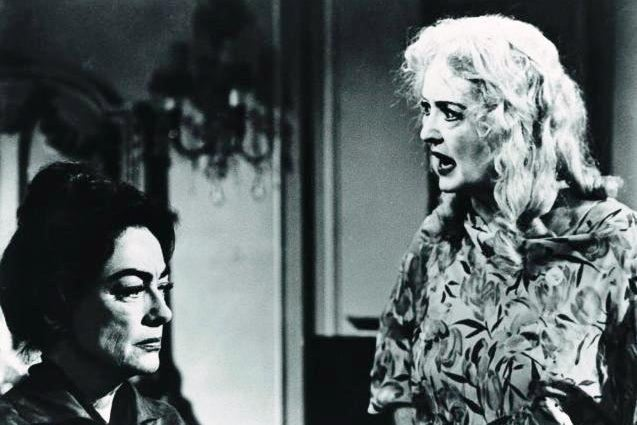 Joan Crawford and Bette Davis in an argument.