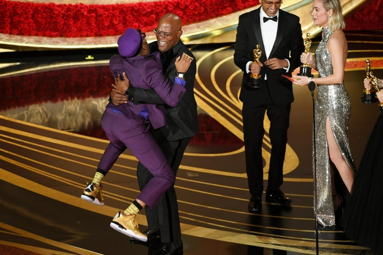 HOLLYWOOD, CALIFORNIA - FEBRUARY 24: Spike Lee accepts the Best Adapted Screenplay award for 'BlacKkKlansman' from Samuel L. Jackson onstage during the 91st Annual Academy Awards at Dolby Theatre on February 24, 2019 in Hollywood, California. (Photo by Kevin Winter/Getty Images)