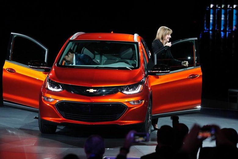 Mary Barra steps out of a Chevy Bolt.