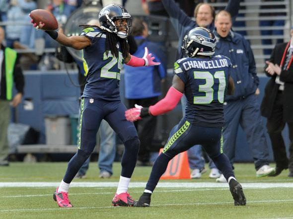 Cornerback Richard Sherman #25 of the Seattle Seahawks celebrates an interception with teammate strong safety Kam Chancellor #31 of the Seattle Seahawks