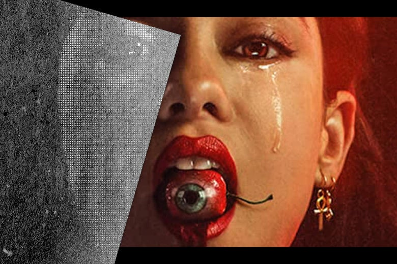 A woman with an a cherry that resembles an eyeball in her mouth.