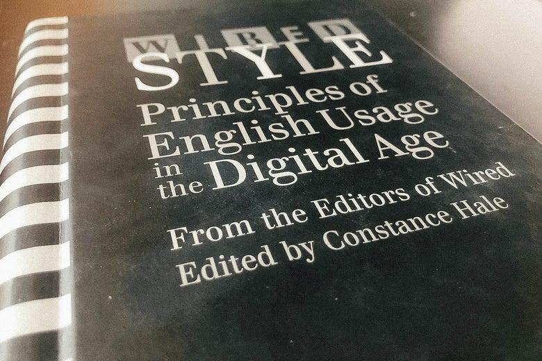 Spiral-bound Wired Style book on a desk