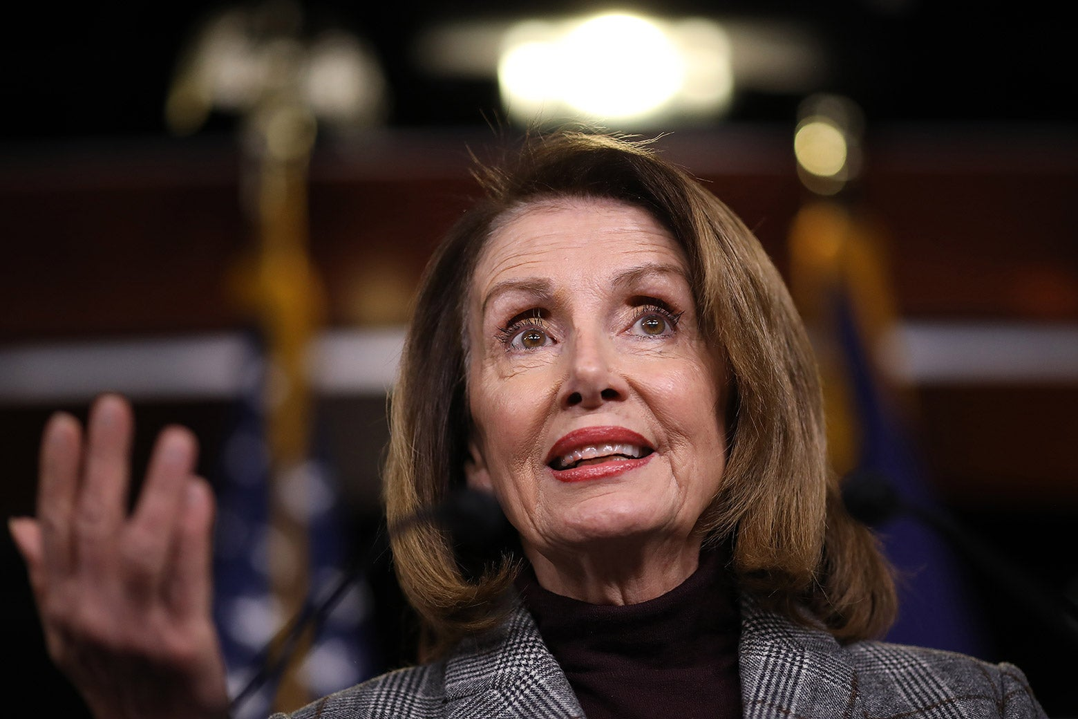 Nancy Pelosi answers questions during her weekly press conference.