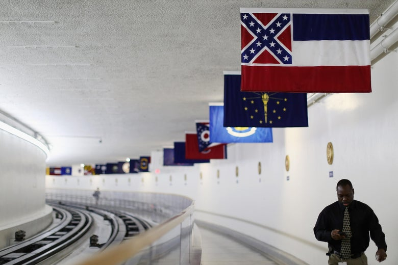 State and territory flags hang from the ceiling of the tunnel, with Mississippi's flag in front