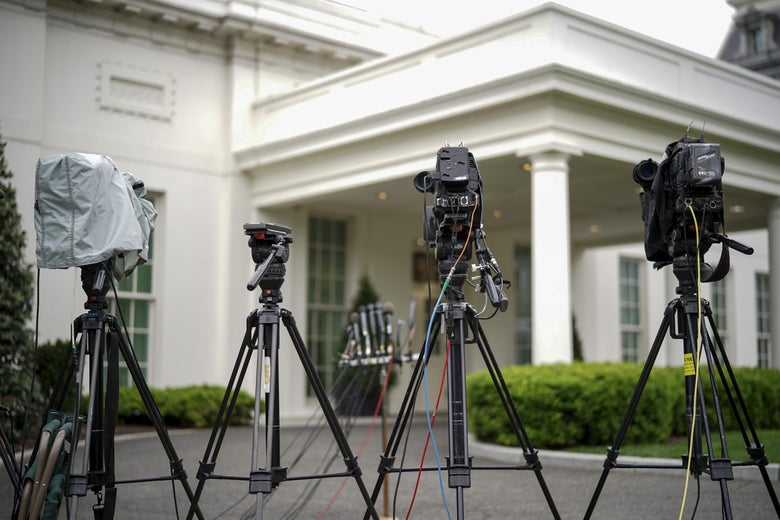 Television cameras are set up outside the West Wing of the White House.