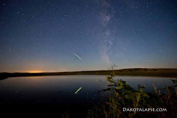Meteor reflected in a lake.