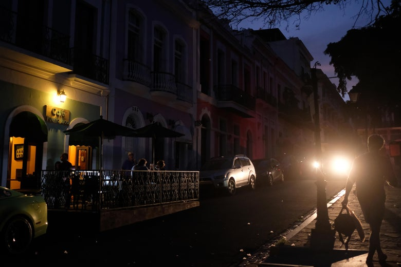 Tourists dine at a darkened sidewalk cafe in Old San Juan, Puerto Rico as a major failure knocked out the electricity in Puerto Rico , leaving the entire island without power nearly seven months after Hurricane Maria destroyed the electrical grid.