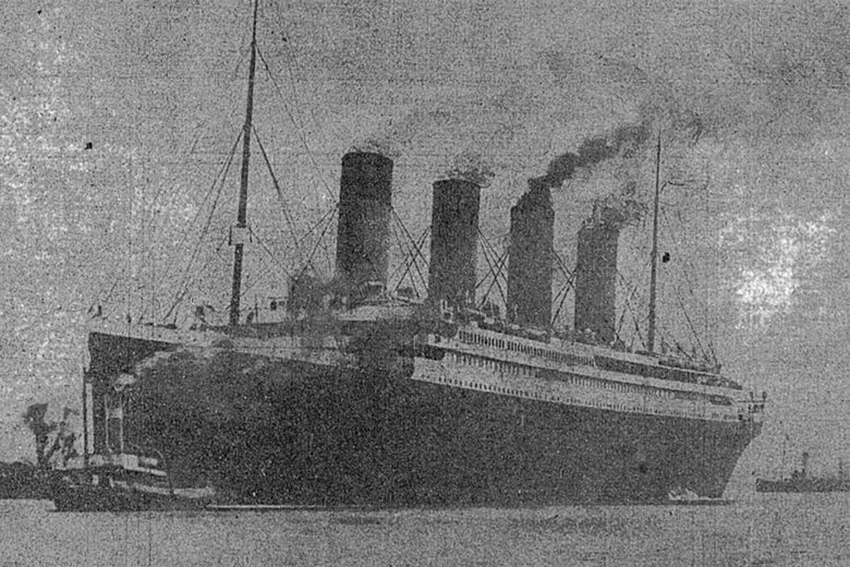 The lost Titanic being towed out of Belfast Harbor.