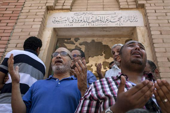 Mourners attend the funeral of Ammar Badie (38), son of the Muslim Brotherhood's Supreme Guide, Mohammed Badie at the Katameya cemetery in the New Cairo.