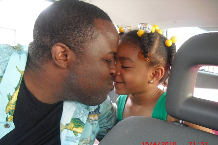 Chinedu Okobi with his daughter Christina