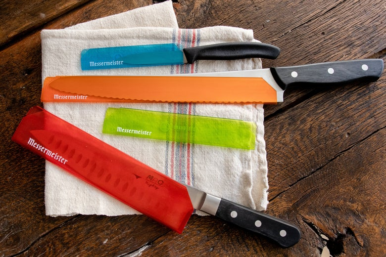 Messermeister knives inside colorful see-through blade guards.