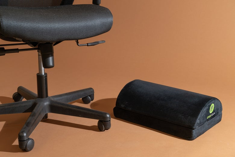 An office chair with the ErgoFoam Adjustable Foot Rest