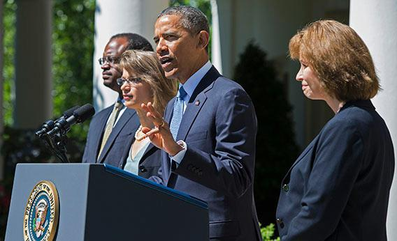 US President Barack Obama (C) gestures as he nominates Cornelia T. L. Pillard (R), a law professor; Patricia Ann Millett (2nd L), an appellate lawyer; and Robert L. Wilkins (L), a federal district judge, to fill the remaining vacancies on the United States Court of Appeals for the District of Columbia Circuit during an event in the Rose Garden at the White House in Washington, DC, June 4, 2013.