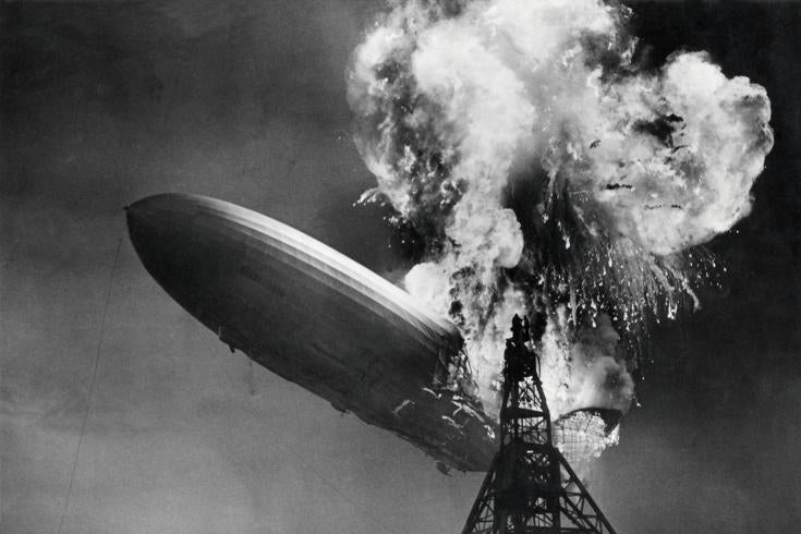 The Hindenburg crashes while engulfed in flames.