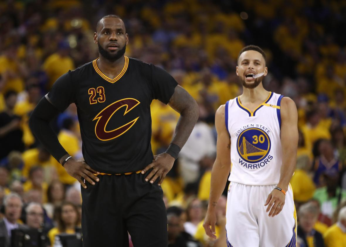 de007d786889 LeBron James  23 of the Cleveland Cavaliers and Stephen Curry  30 of the  Golden State Warriors look on during the first half in Game 5 of the 2017  NBA ...