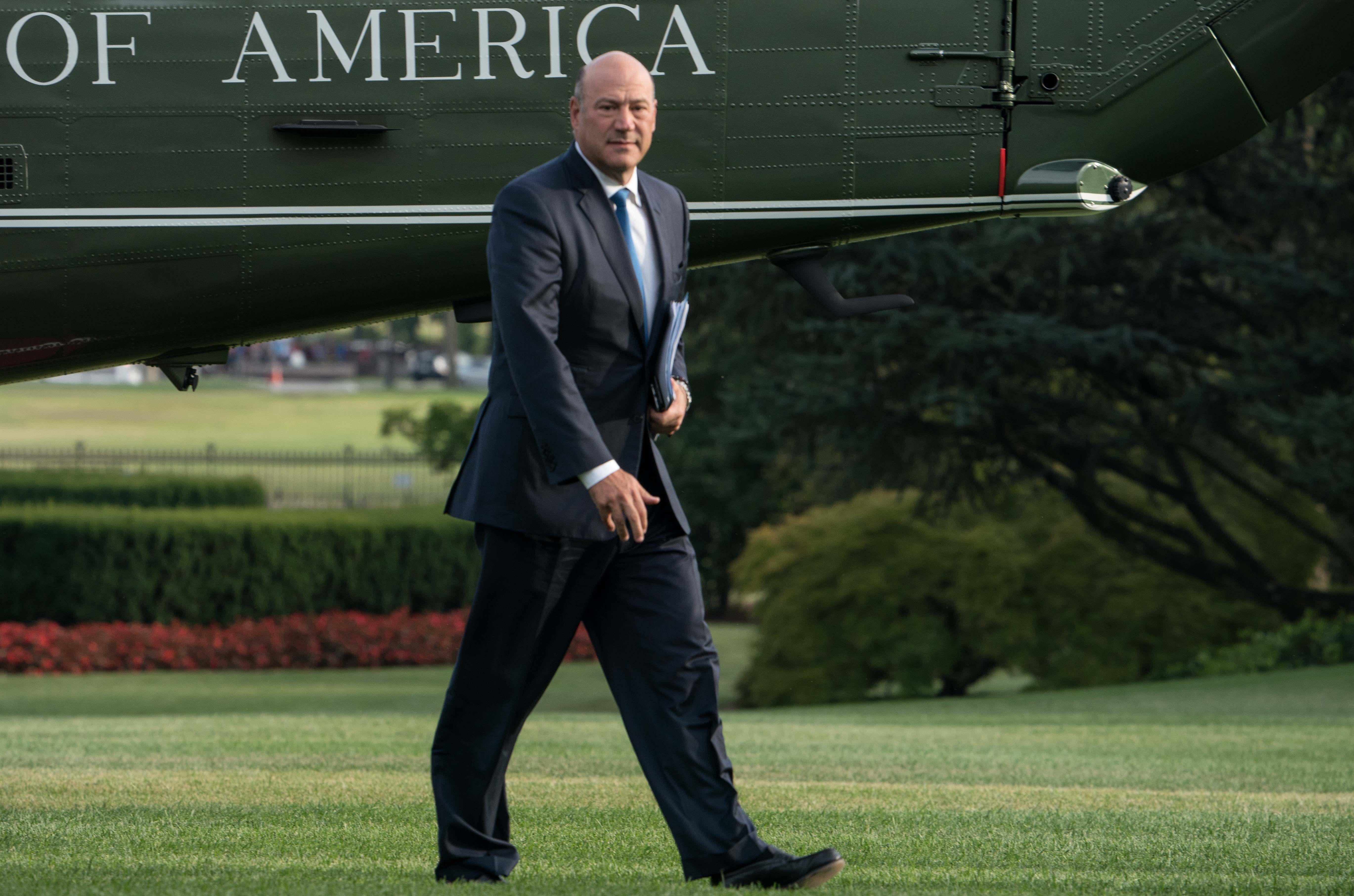 White House economic adviser Gary Cohn walks to the White House in Washington, DC, on August 30, 2017 upon return from Springfield, Missouri, where President Donald Trump spoke about tax reform.