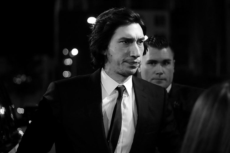 In black and white, Adam Driver wears a nice suit.