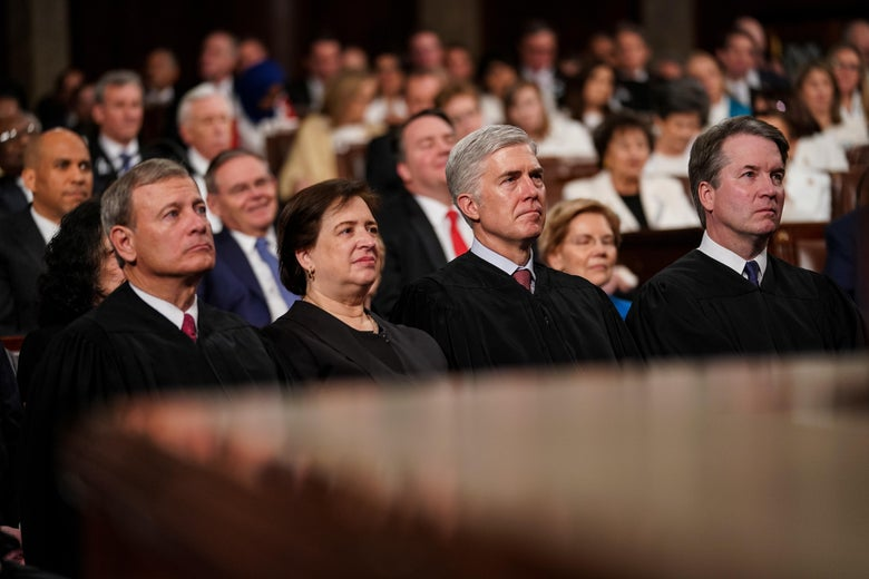 John Roberts, Elena Kagan, Neil Gorsuch, and Brett Kavanaugh seated in the Capitol
