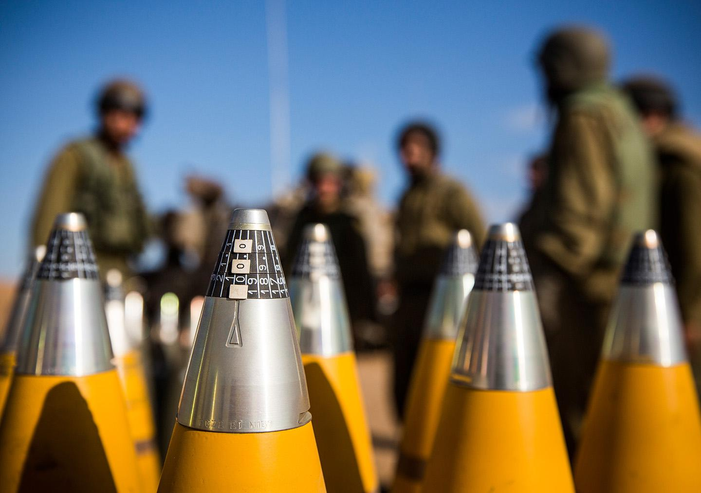 Israeli artillery shells sit waiting to be fired into Gaza.