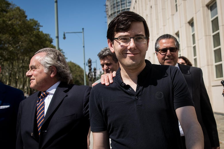 Defense attorney Benjamin Brafman walks with former pharmaceutical executive Martin Shkreli after the jury issued a verdict at the U.S. District Court for the Eastern District of New York on August 4, 2017 in the Brooklyn borough of New York City.