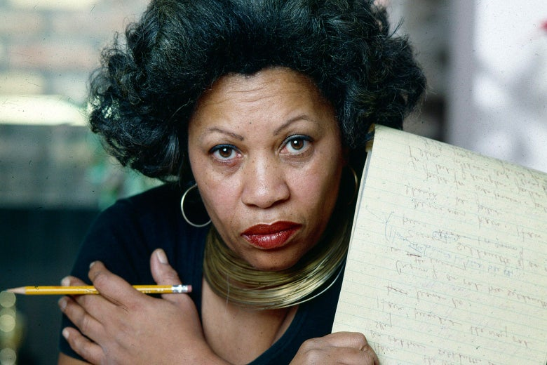 Toni Morrison holds a legal pad and pencil.