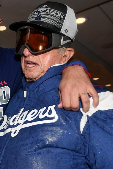 LOS ANGELES, CA - OCTOBER 01:  Manny Machado #8 of the Los Angeles Dodgers celebrates a 5-2 win over the Colorado Rockies with Tommy Lasorda after the National League West tiebreaker game at Dodger Stadium on October 1, 2018 in Los Angeles, California.  (Photo by Harry How/Getty Images)