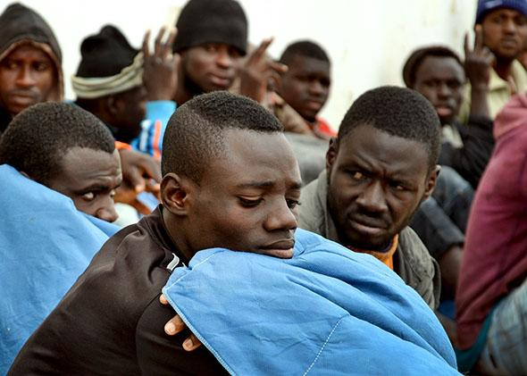 Illegal migrants after they were rescued by fishermen when their,Illegal migrants after they were rescued by fishermen when their boat got into difficulties while trying to sail from Libya to Europe.