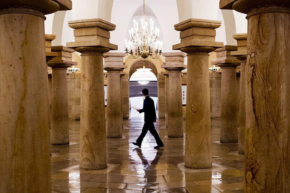 A US Senate employee walks through the Capitol Crypt, Sept. 25, 2013.