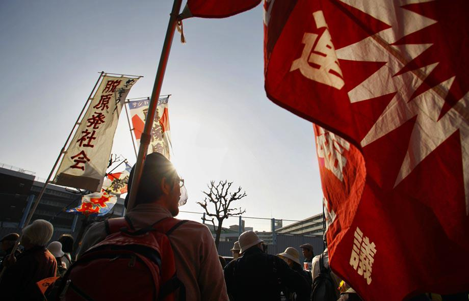 Protesters hold banners and flags during an anti-nuclear demonstration in Tokyo, Saturday, March 9, 2013.