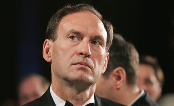 US Supreme Court Justice Samuel Alito listens as US President George W. Bush speaks at the the Federalist Society's 25th Anniversary Gala Dinner at Union Station in Washington, DC 15 November 2007.