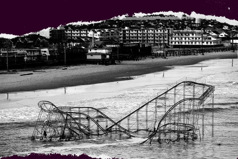 A roller coaster partially submerged by hurricane waters, with boardwalk attractions on the beach in the background.