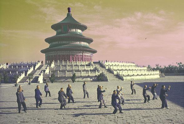 Men doing tai chi in front of the Hall of Prayer for Good Harvests at the Temple of Heaven complex in Beijing, China.