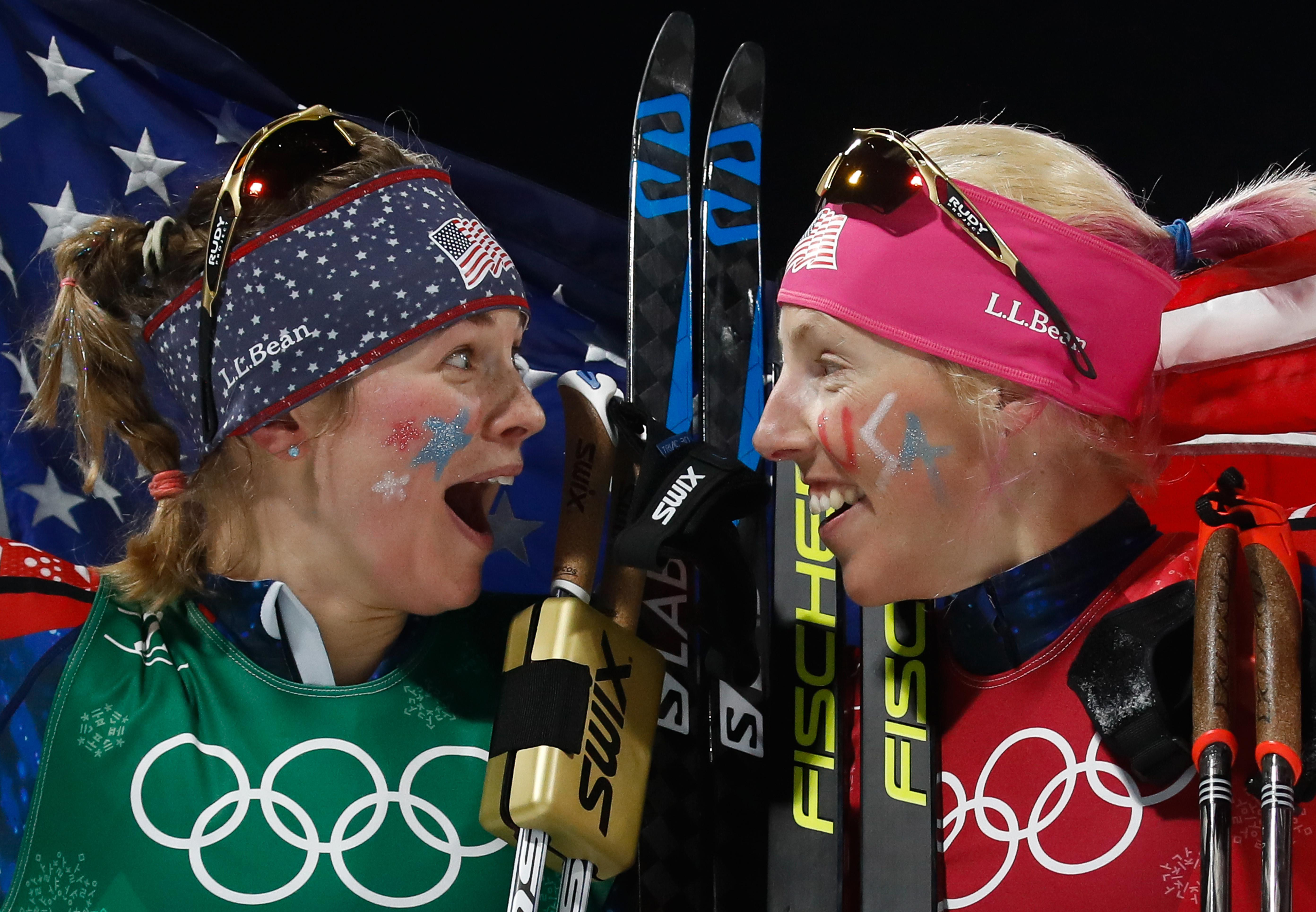 TOPSHOT - USA's Jessica Diggins (L) and USA's Kikkan Randall celebrate winning gold in the women's cross country team sprint free final at the Alpensia cross country ski centre during the Pyeongchang 2018 Winter Olympic Games on February 21, 2018 in Pyeongchang.  / AFP PHOTO / Odd ANDERSEN        (Photo credit should read ODD ANDERSEN/AFP/Getty Images)