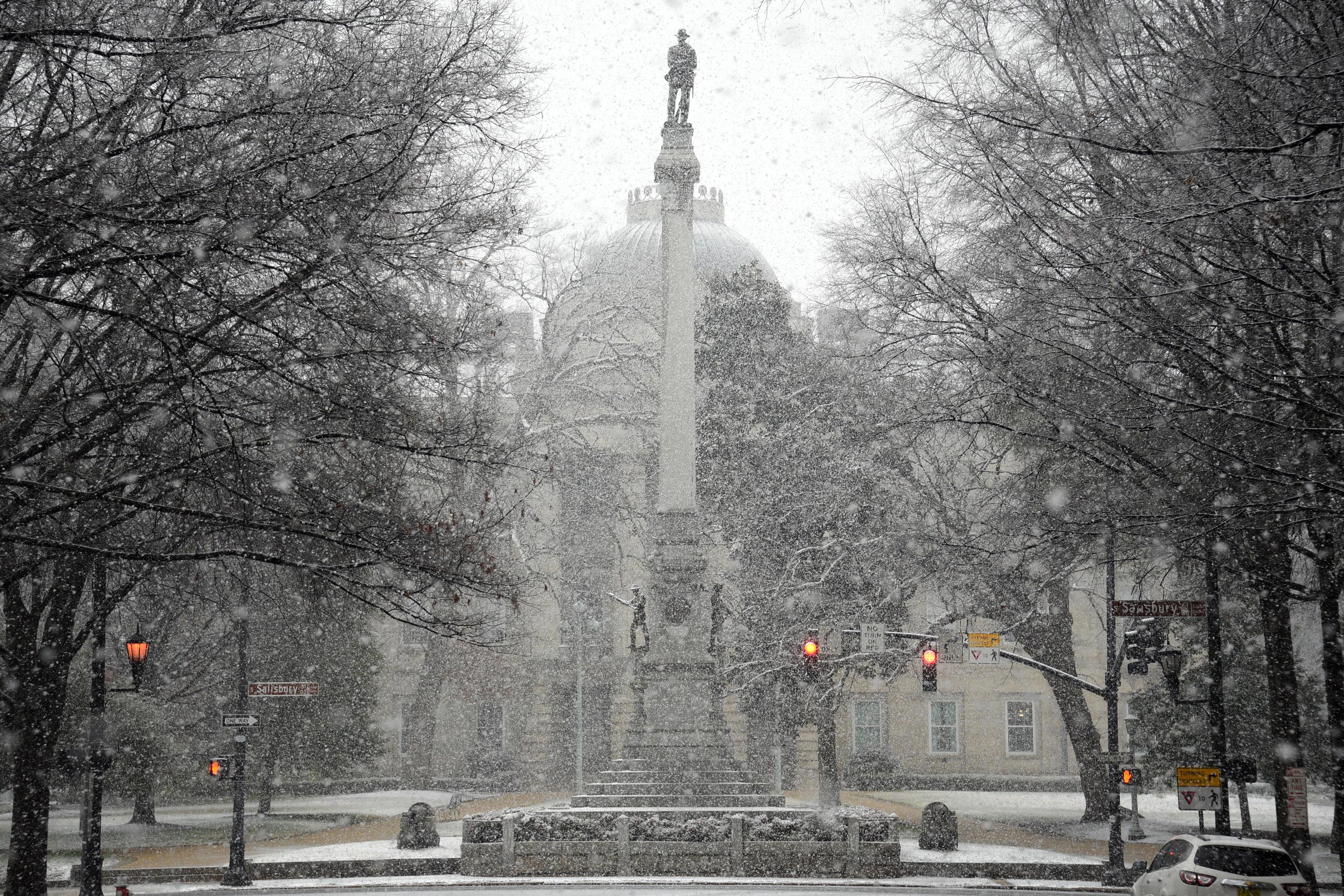 RALEIGH, NC - JANUARY 17: Snow falls on the Confederate Soldiers Monument at the State Capitol on January 17, 2018 in Raleigh, North Carolina. Governor Roy Cooper declared a State of Emergency yesterday ahead of the winter storm. (Photo by Lance King/Getty Images)