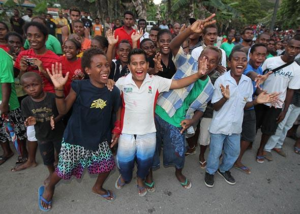 Locals cheer on Sept. 16, 2012, in Honiara, Guadalcanal Island in the Solomons.