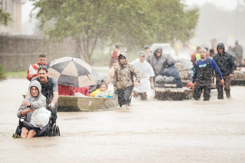 People are rescued from a flooded neighborhood after it was inundated with rainwater, remnants of Hurricane Harvey, on Aug. 28 in Houston.