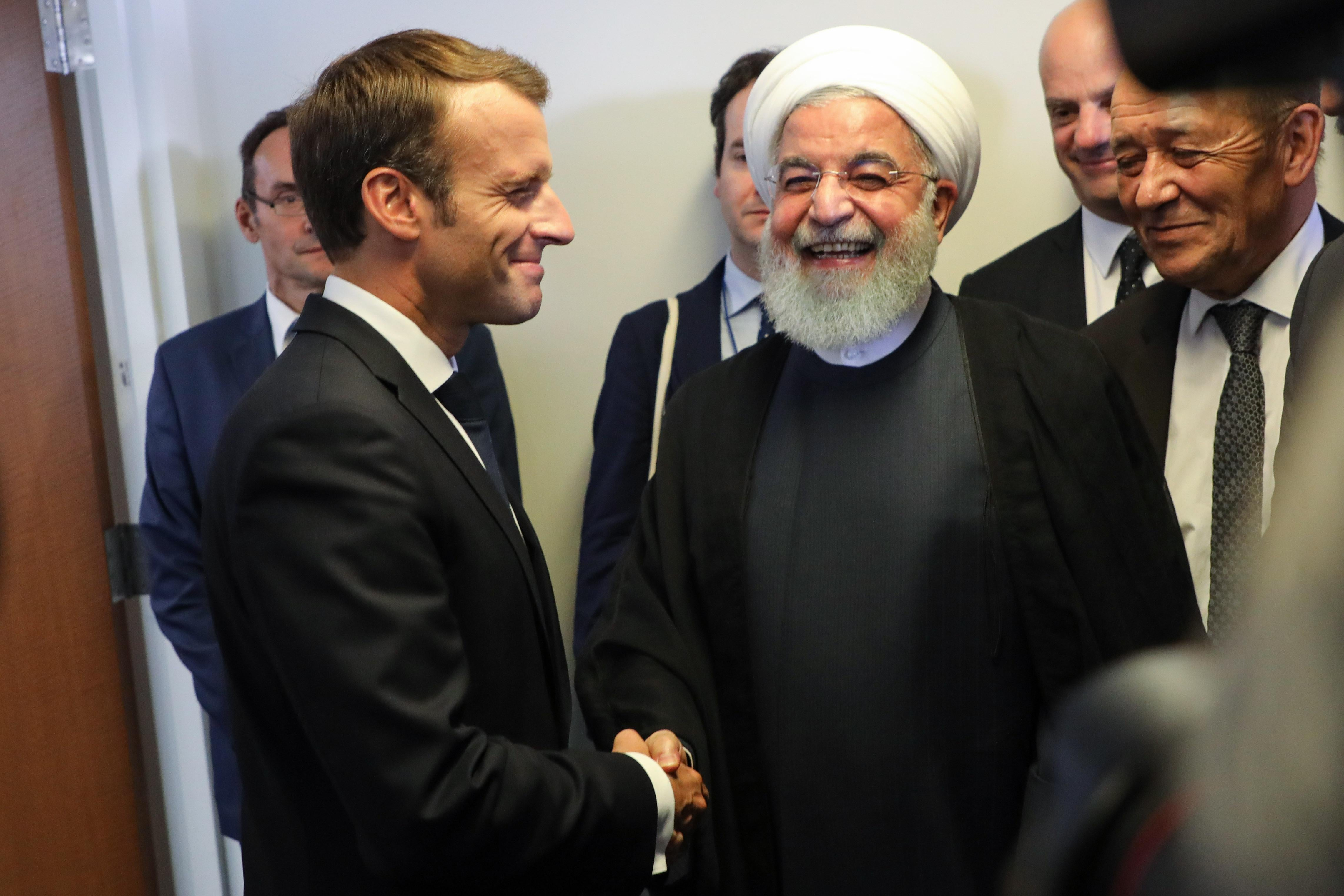 Macron shaking hands with Rouhani.