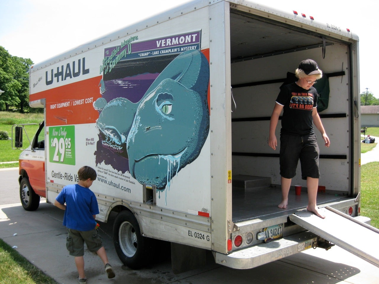 A woman and a boy in a moving van.