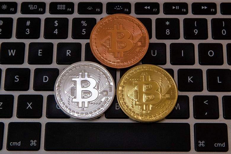 Bitcoin atop a laptop keyboard