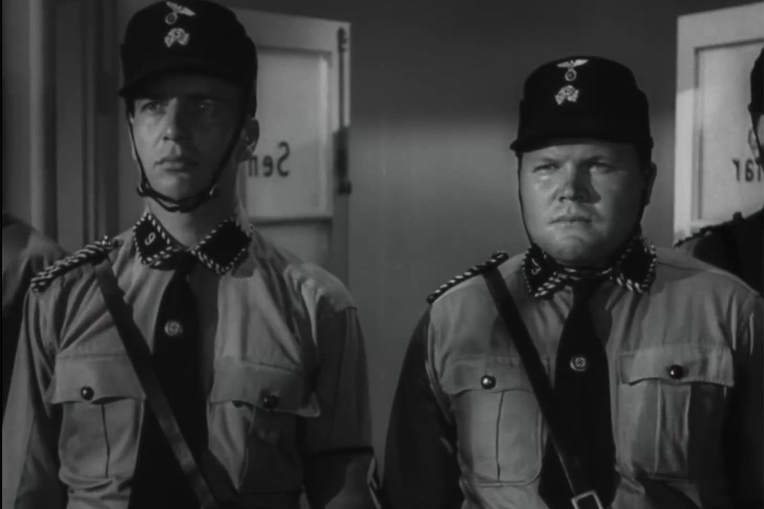 Two stooges in Nazi uniforms.