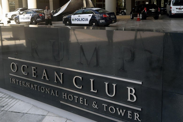 A sign reading Ocean Club Hotel and faint lettering above that once spelled T-R-U-M-P